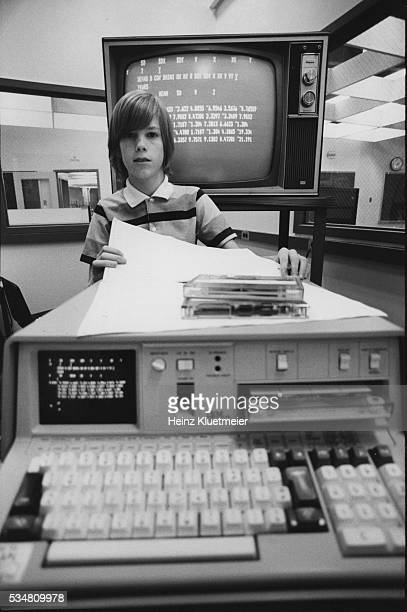Portrait of a Wilde Lake High School freshman poses behind an IBM computer, Columbia, Maryland, 1977.