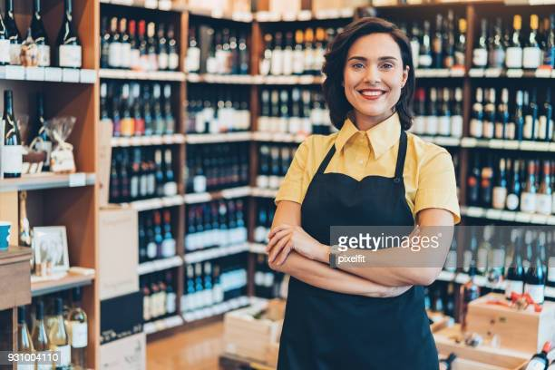 portrait of a wine shop owner - liquor store stock pictures, royalty-free photos & images