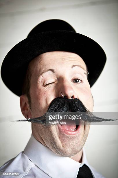 Portrait of a winking man with mustache and hat