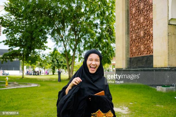 portrait of a woman after eid pray - indonesian culture stock pictures, royalty-free photos & images