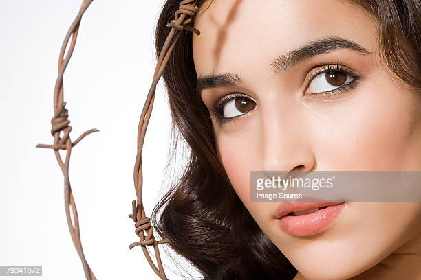 Portrait of a woman and barbed wire