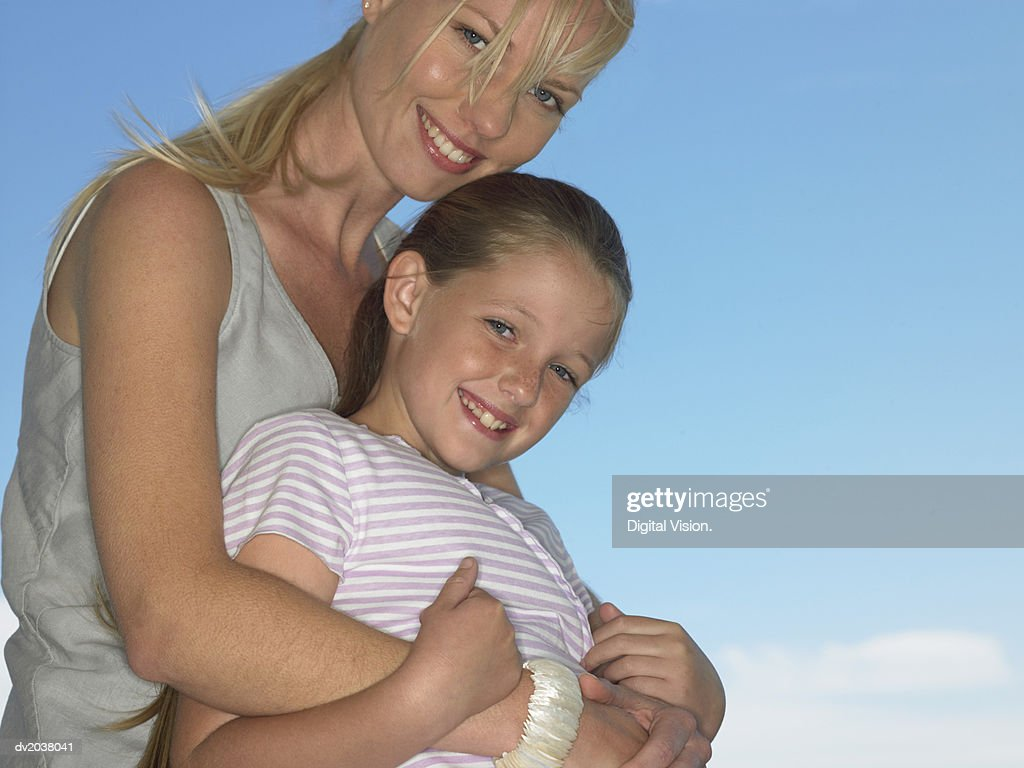 Portrait of a Woman and Her Young Daughter : Stock Photo