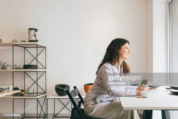 portrait of a woman artisan sitting at her studio - art dealer stock pictures, royalty-free photos & images