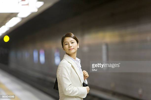 Portrait of a woman at platform, smiling