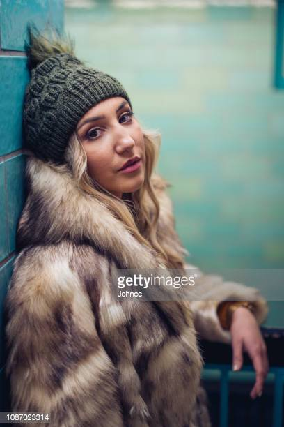 portrait of a woman at subway - medium shot stock pictures, royalty-free photos & images