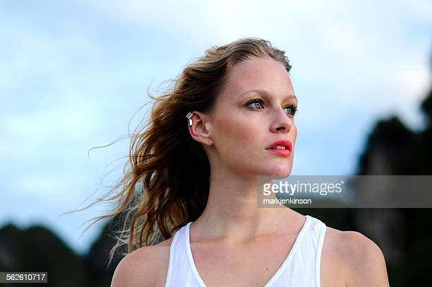 portrait of a woman at the beach - earring stock pictures, royalty-free photos & images