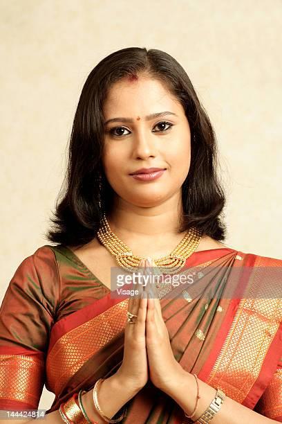 Portrait of a woman doing Namaste