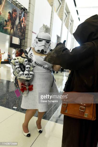 Portrait of a woman dressed as 'Miss Stormtrooper' as she attends the Star Wars Celebration event at Wintrust Arena, Chicago, Illinois, April 13,...