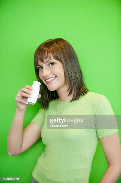 Portrait of a woman drinking probiotic drink