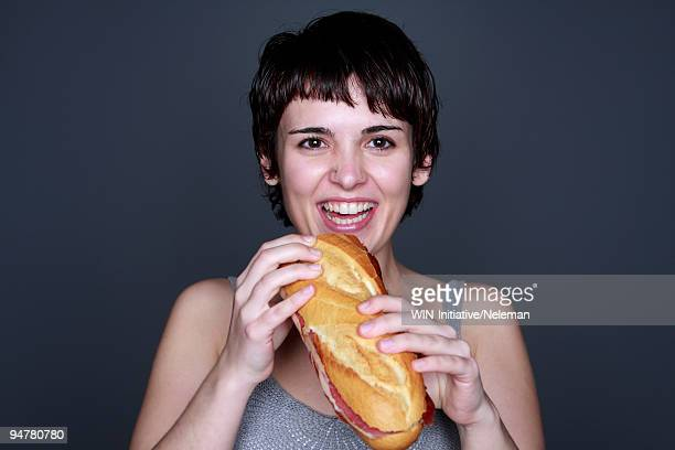 Portrait of a woman eating a sandwich
