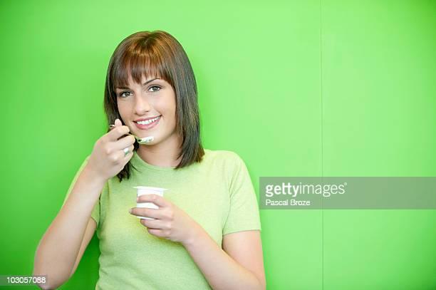 Portrait of a woman eating yogurt