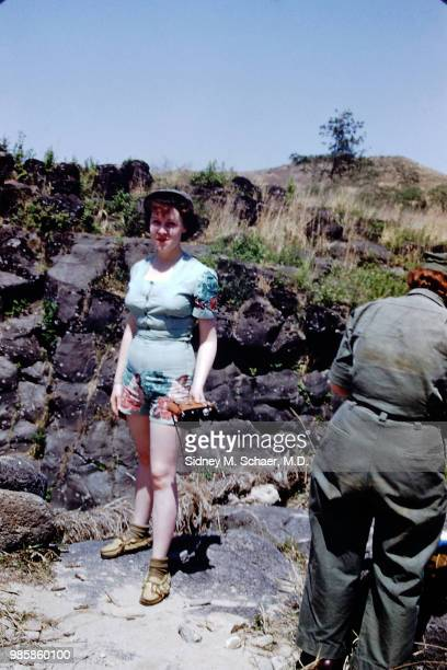 Portrait of a woman from the 8063rd MASH as she poses with a camera in her hand near a swimming hole South Korea May 1952