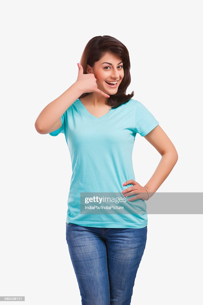 Portrait of a woman gesturing : Stock Photo