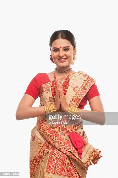 portrait of a woman greeting in traditional clothing - prayer pose greeting bildbanksfoton och bilder