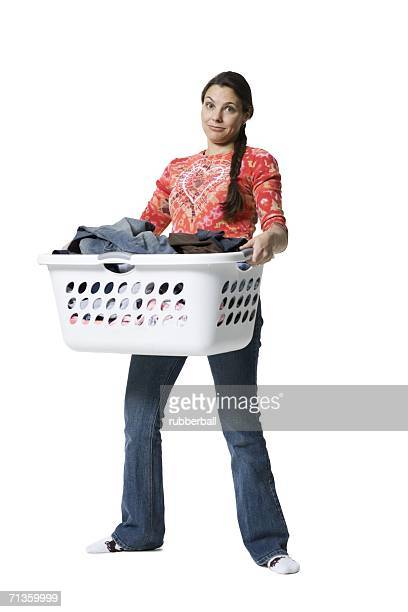 Portrait of a woman holding a basket of clothes