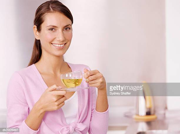 Portrait of a Woman Holding a Cup of Herbal Tea