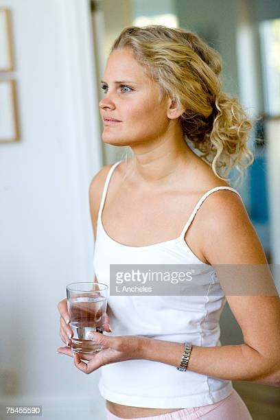 Portrait of a woman holding a drinking glass.