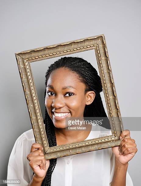 Portrait of a woman holding a picture frame