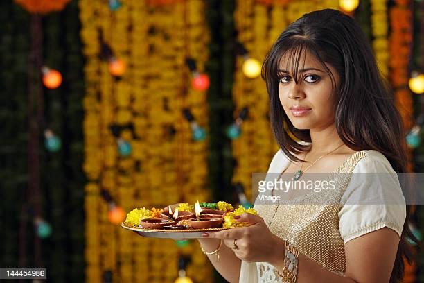 Portrait of a woman holding a pooja thali, Diwali