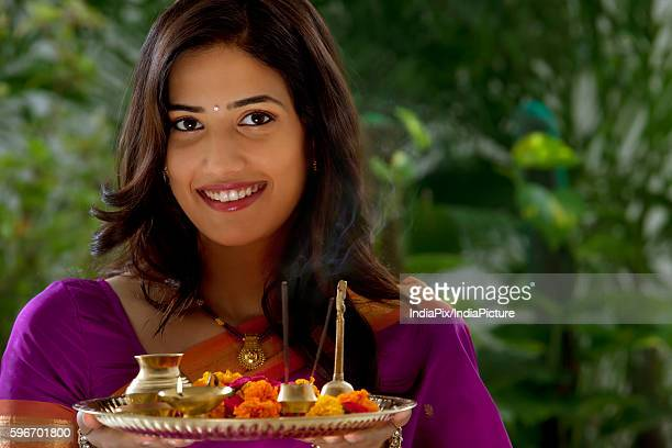 portrait of a woman holding a tray - mangala sutra fotografías e imágenes de stock