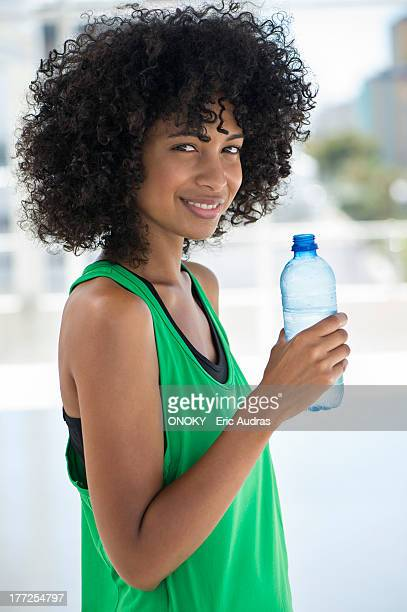 Portrait of a woman holding a water bottle and smiling