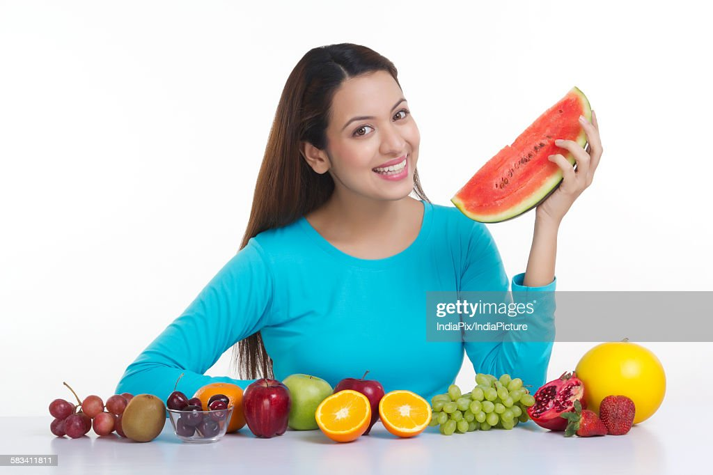 Portrait of a woman holding a watermelon : Stock Photo
