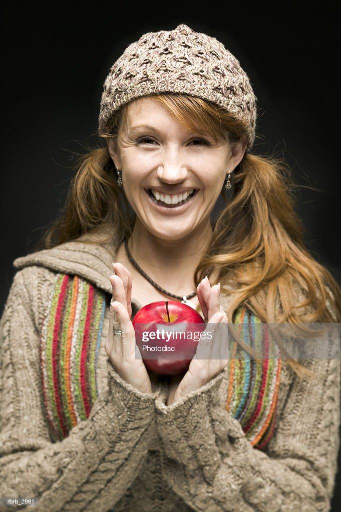 Portrait of a woman holding an apple : Foto de stock