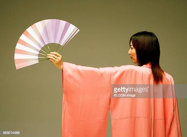 Portrait Of A Woman Holding Fan