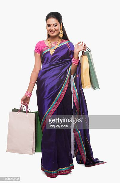 Portrait of a woman holding shopping bags on Gudi Padwa festival