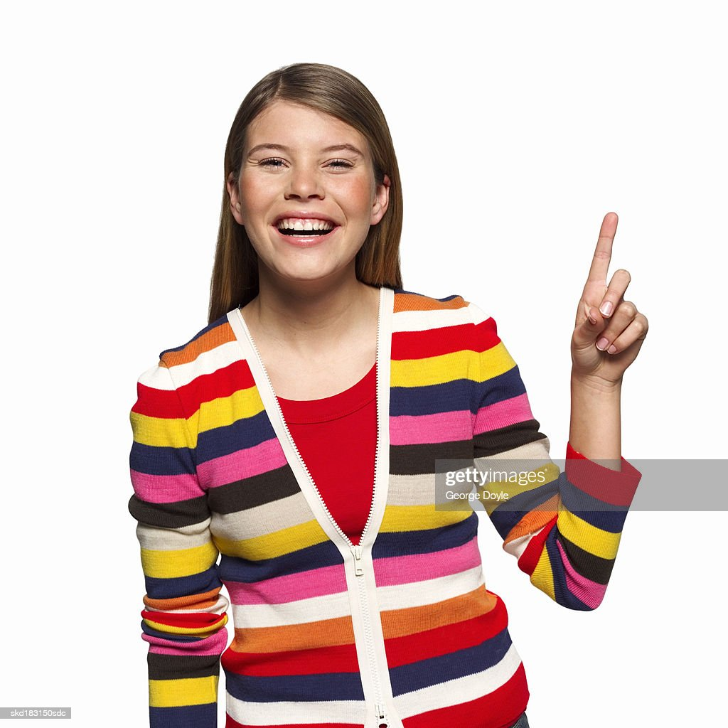 Portrait of a woman holding up a finger : Stock Photo