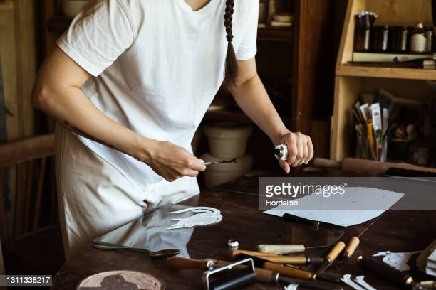 portrait of a woman holding working tools - lino stock pictures, royalty-free photos & images