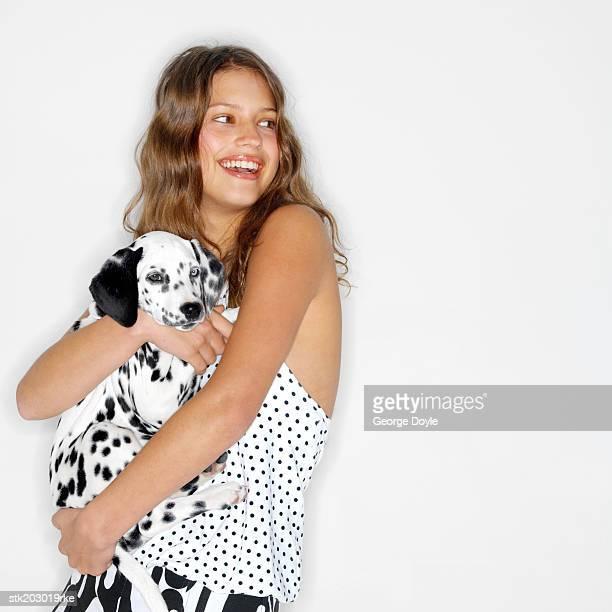 portrait of a woman hugging her dalmatian dog - dalmata imagens e fotografias de stock