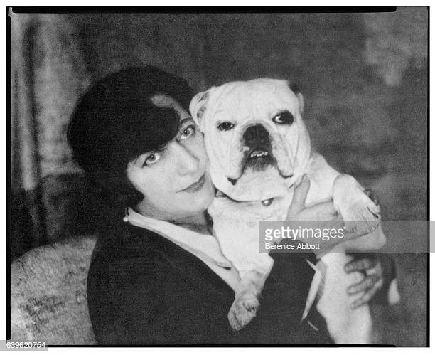 Portrait of a woman identified as 'Mme Guerin' as she poses with a bulldog in her arms Paris France 1920s She was the mother of author and artist...