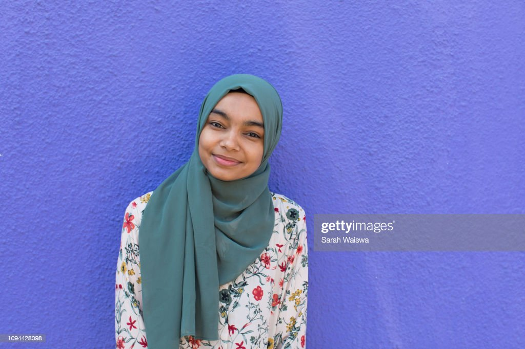 Portrait of a woman in a hijab smiling : Stock Photo