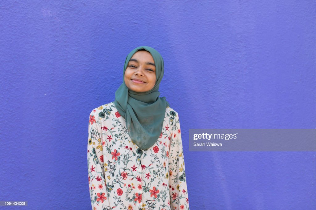 Portrait of a woman in a hijab smiling