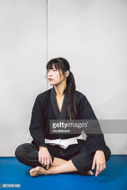 portrait of a woman in a kimono - martial arts stock pictures, royalty-free photos & images