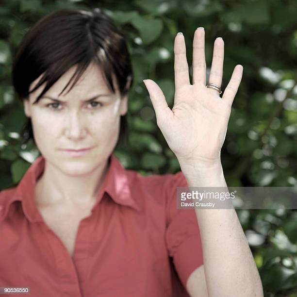 portrait of a woman in a red blouse waving - crausby stock pictures, royalty-free photos & images