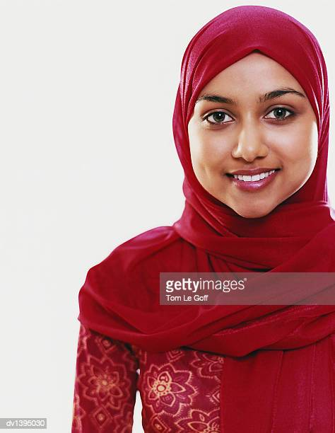 Portrait of a Woman in a Red Hijab