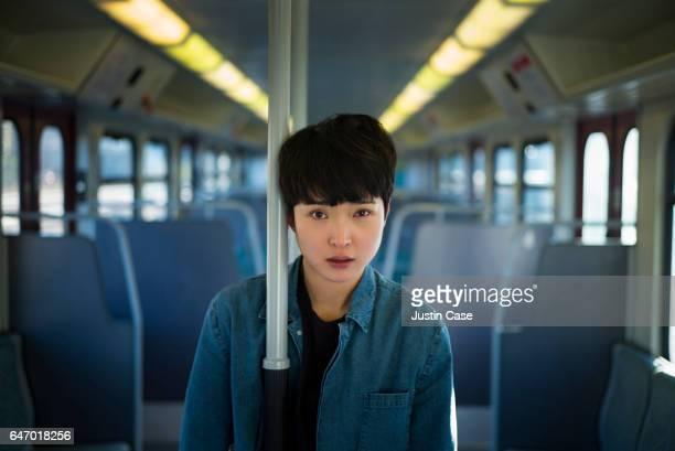 portrait of a woman in a train - koreanischer abstammung stock-fotos und bilder