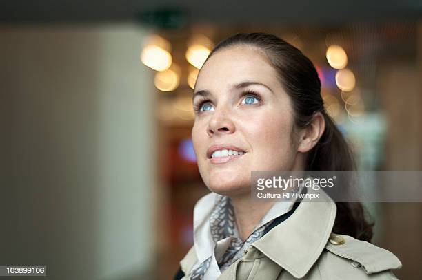 portrait of a woman in airport - anticipation stock pictures, royalty-free photos & images
