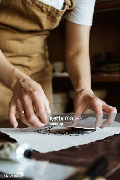 portrait of a woman in an apron - lino stock pictures, royalty-free photos & images