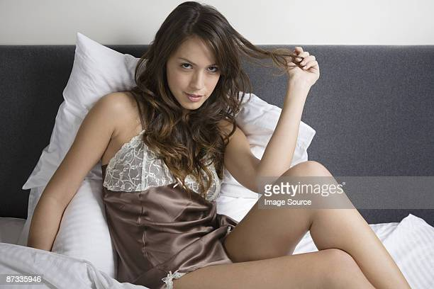 portrait of a woman in bed - women in slips stock photos and pictures