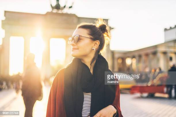 Portrait of a woman in front of Brandenburger Tor in Berlin, Germany