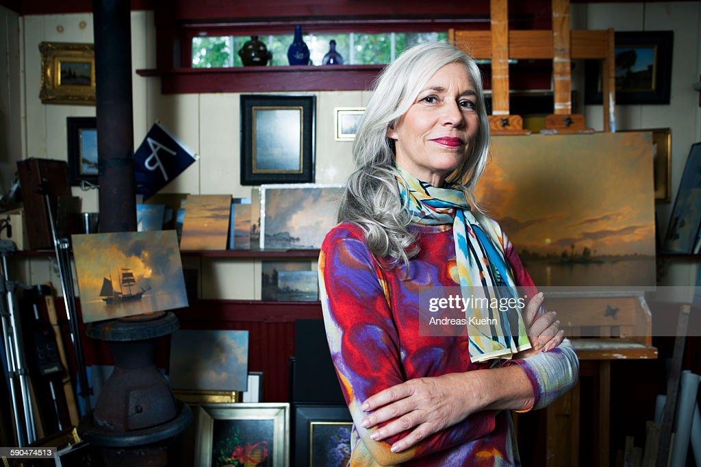 Portrait of a woman in her artist studio. : Stock Photo