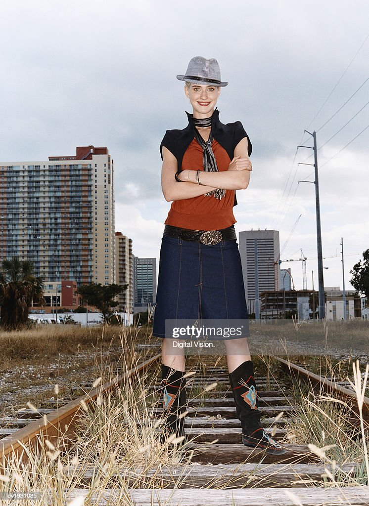 Portrait of a Woman in Individual Clothing Standing on an Abandoned Rail Track : Stock Photo