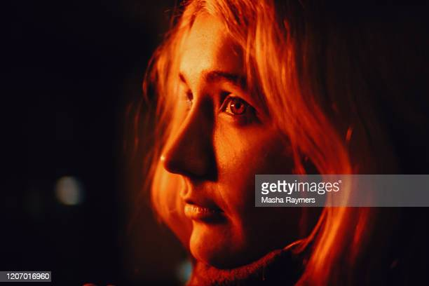 portrait of a woman in red light - red light stock pictures, royalty-free photos & images