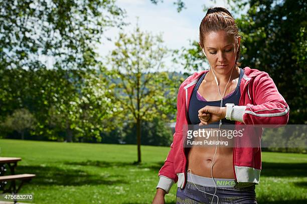 Portrait of a woman in sportswear checking an Apple Watch Sport taken on May 21 2015