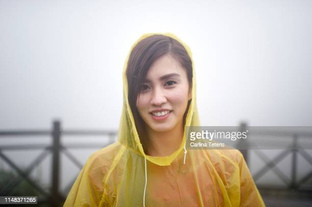 portrait of a woman in the rain - poncho stock pictures, royalty-free photos & images
