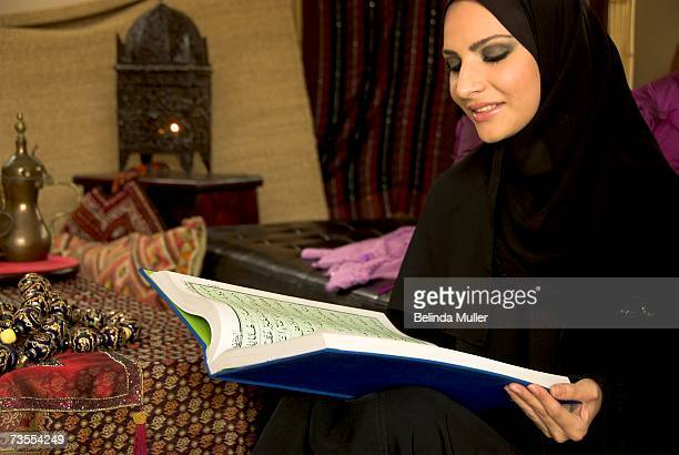 Portrait of a Woman in Traditional Arab Dress Reading the Koran
