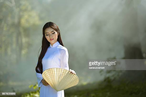 Portrait of a woman in traditional clothing, Vietnam